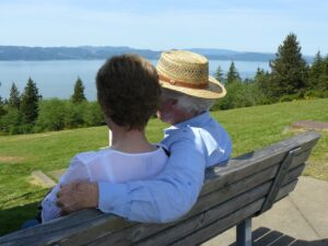 elderly couple sitting on a bench outside, moving, calgary, yyc, relocation, relocate in 2021, estate service, rental property